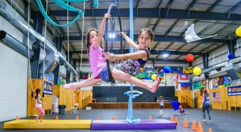 Girls learning how to do circus arts