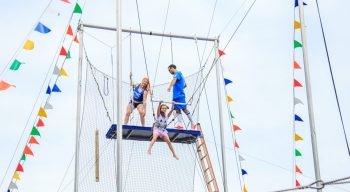 Girl on flying trapeze