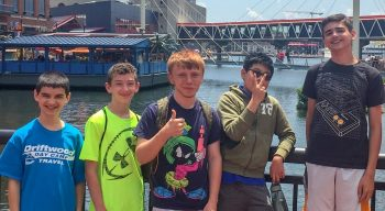 Teens traveling to Boston standing by Seaport area